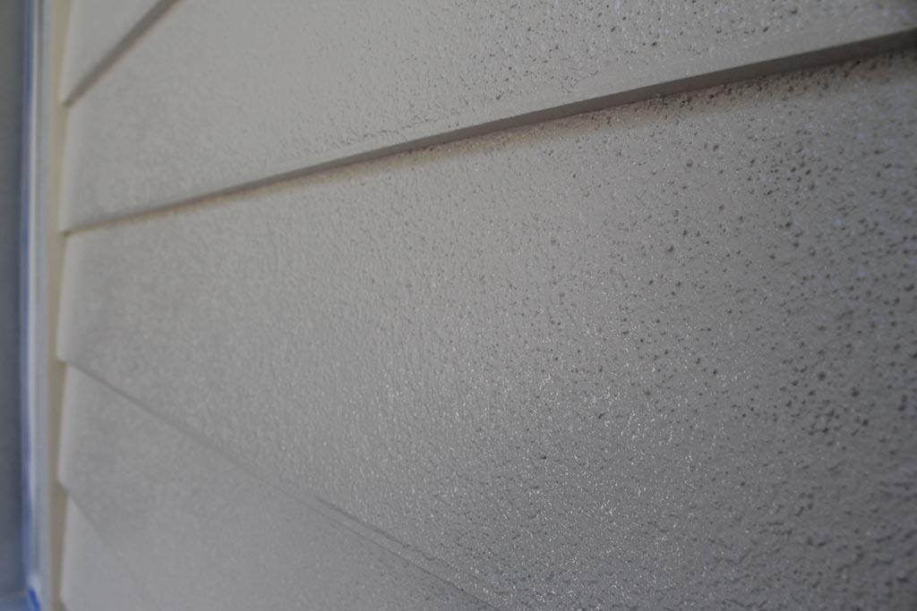 lap siding stucco finish